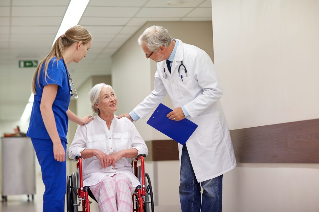 Doctor, nurse and patient in a hospital hallway