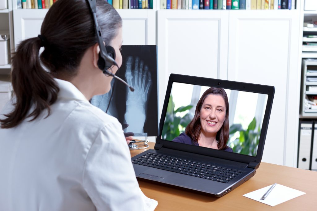 a businesswoman talking with client via VoiP
