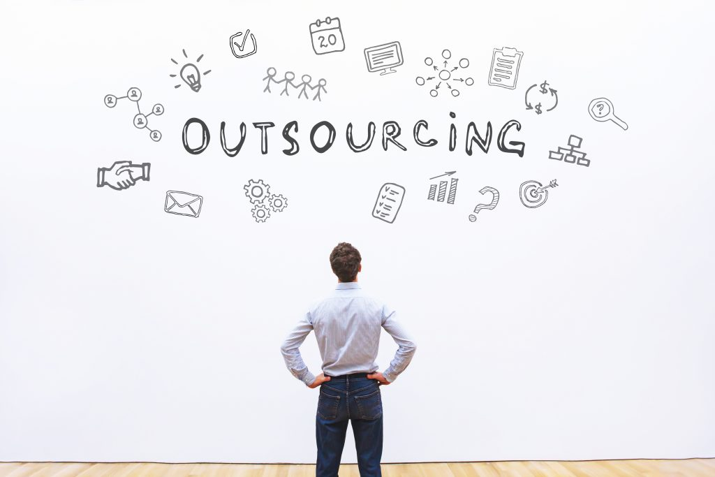 Man looking at a word Outsourcing