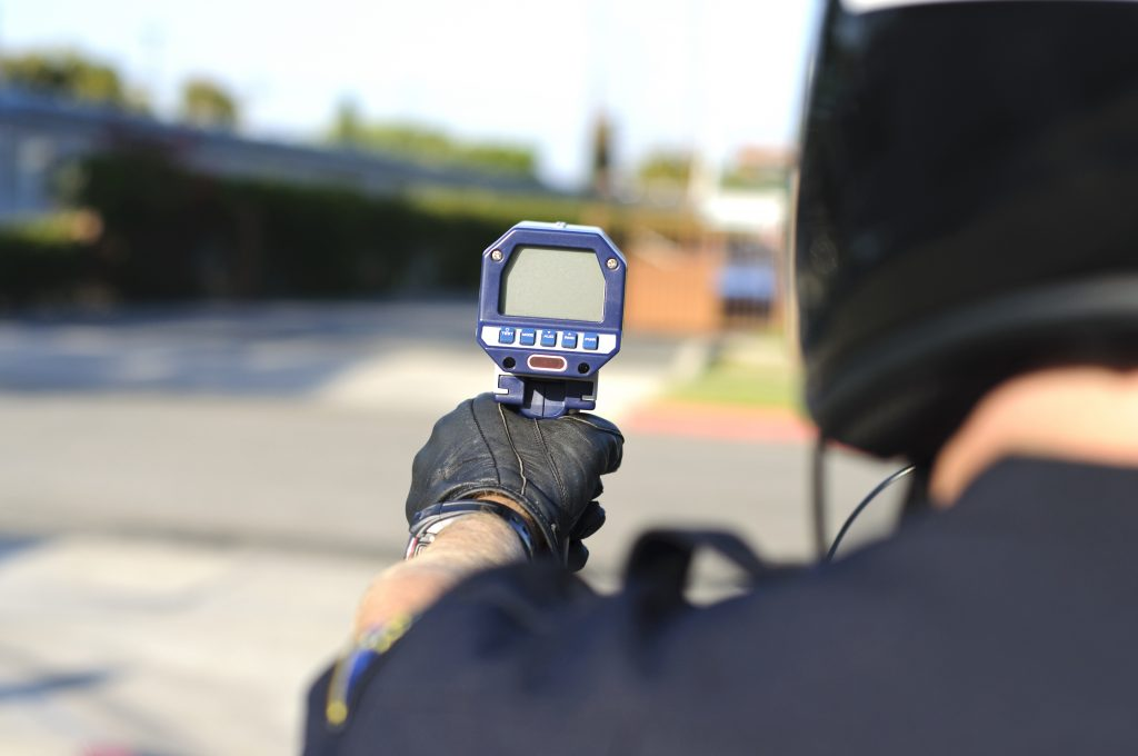 Police officer using a radar gun