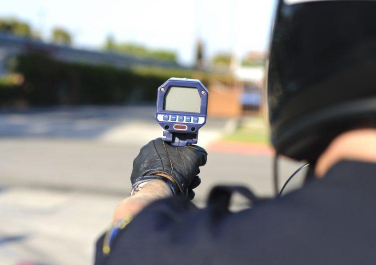 Police officer using a radar gun