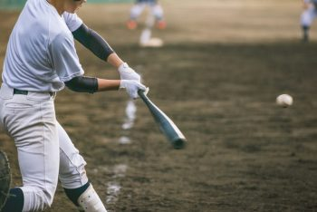 Baseball player about to hit a ball