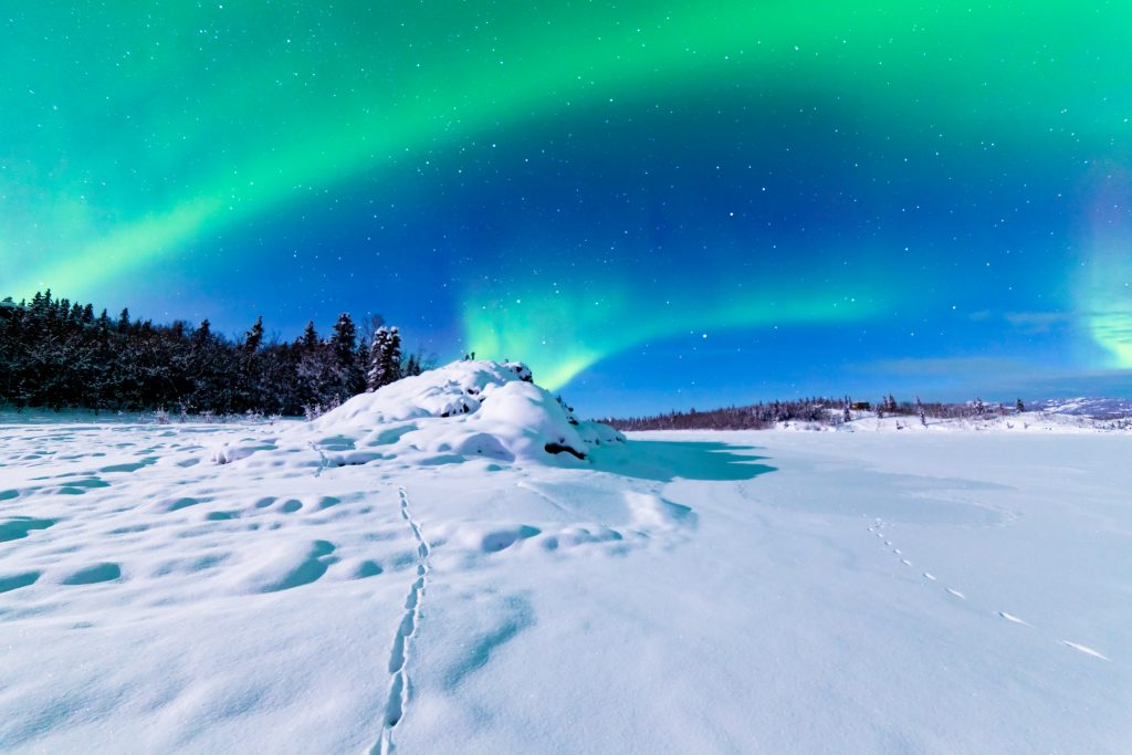 a remote area with the northern lights in the background