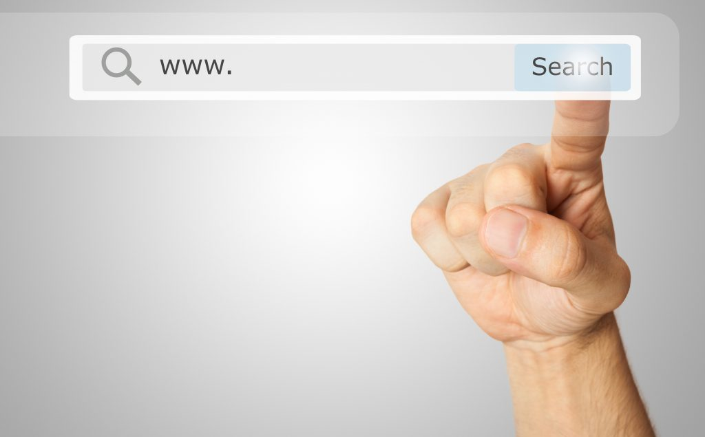 Hand touching search button