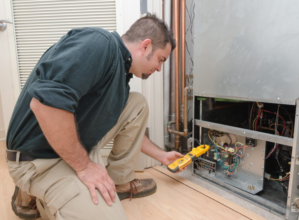 a man checking the heat pump