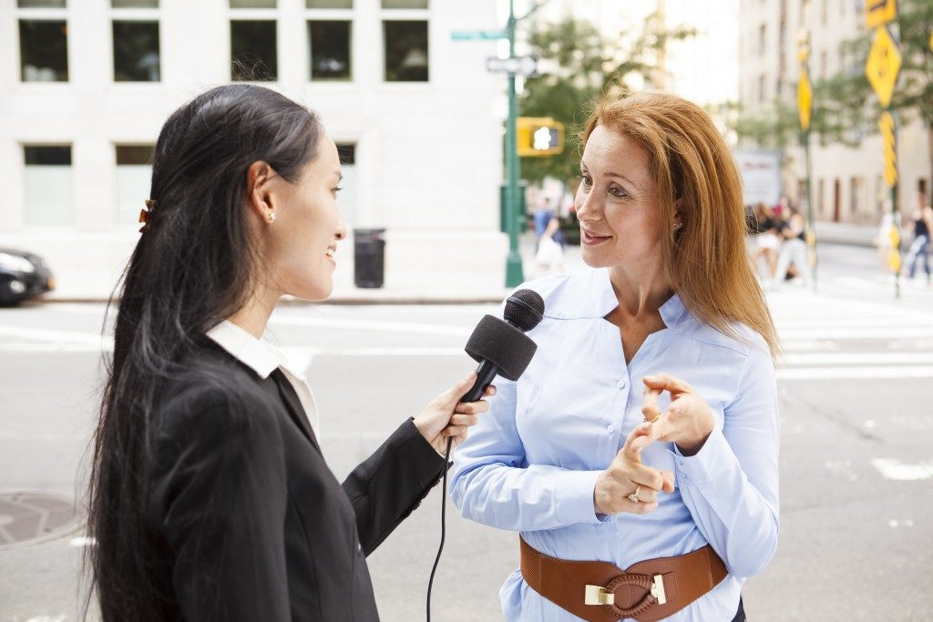 femalre reporter interviewing woman