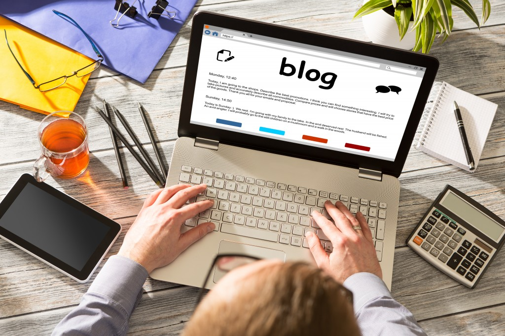 woman writing a blog