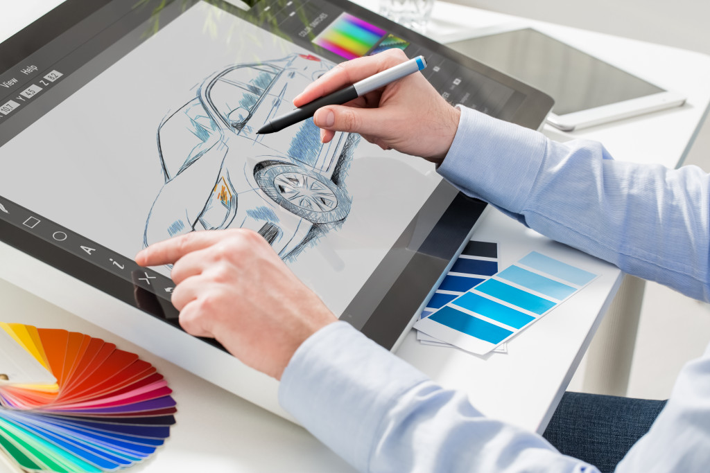 man working on graphics tablet