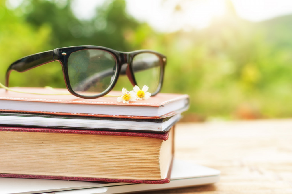 glasses on top of books
