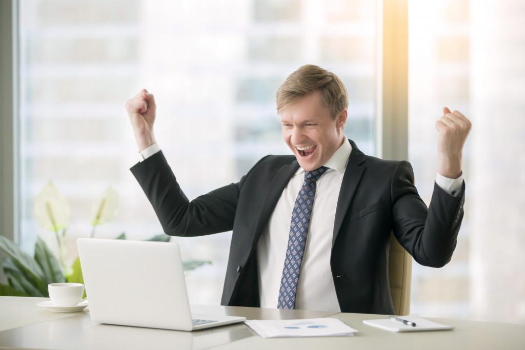 business man cheering